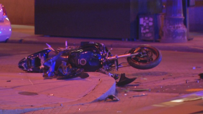Man in Critical, Driver Charged After Car Slams Into Motorcycle