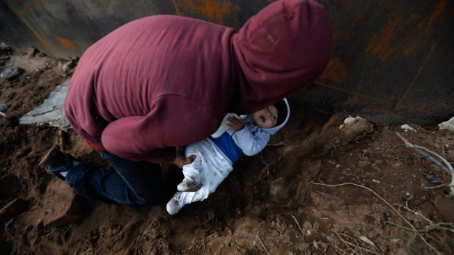 Migrants in Tijuana Trickling Over and Under Border Wall