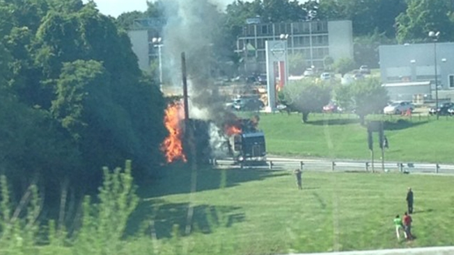 Fire Erupts in Tractor Trailer Filled With Hay
