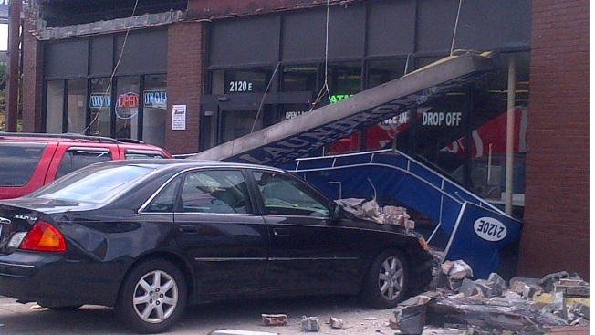 Laundromat Sign Collapses on Parked Cars