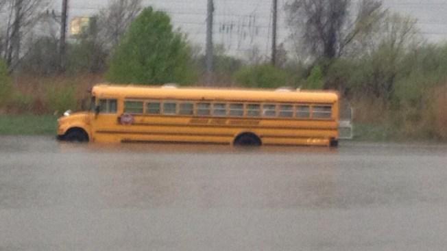 School Children Rescued from Bus Stuck in Water
