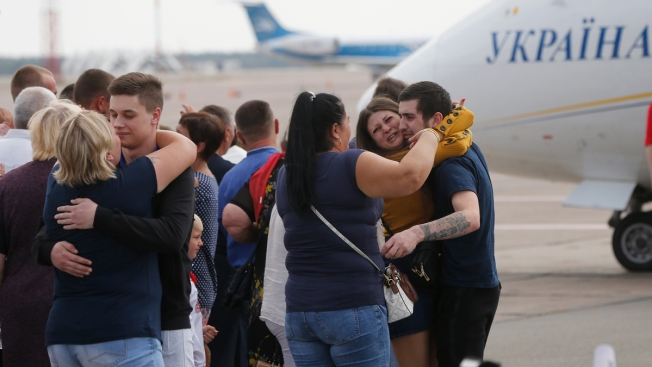 Russia and Ukraine Trade Prisoners, Each Fly 35 to Freedom