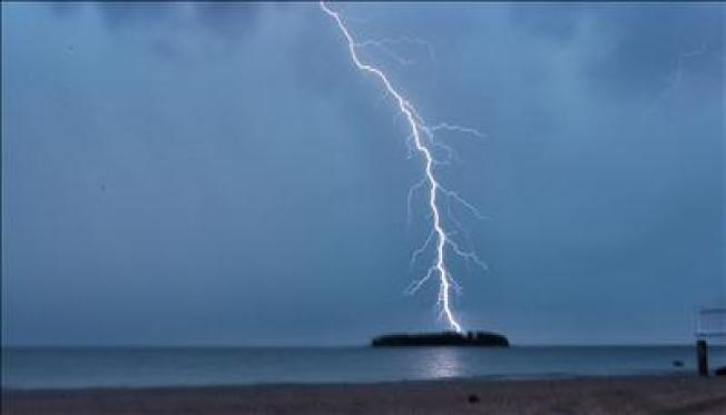 Storms Drench Northeast, Snarl Travel