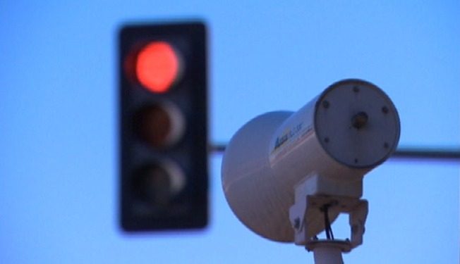 Officials Revise Red Light Camera Program