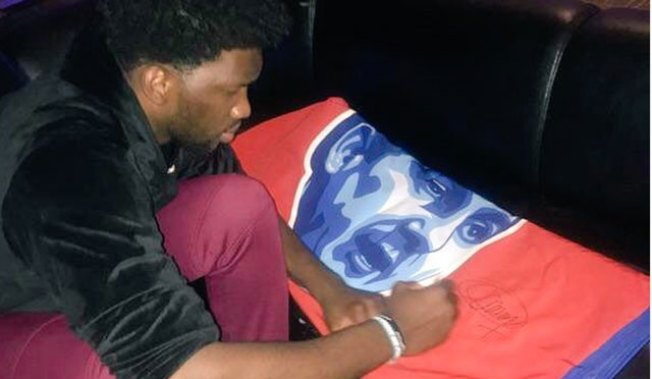 Joel Embiid Watched Draft With Fans at XFINITY Live!, Signed Sam Hinkie Banner