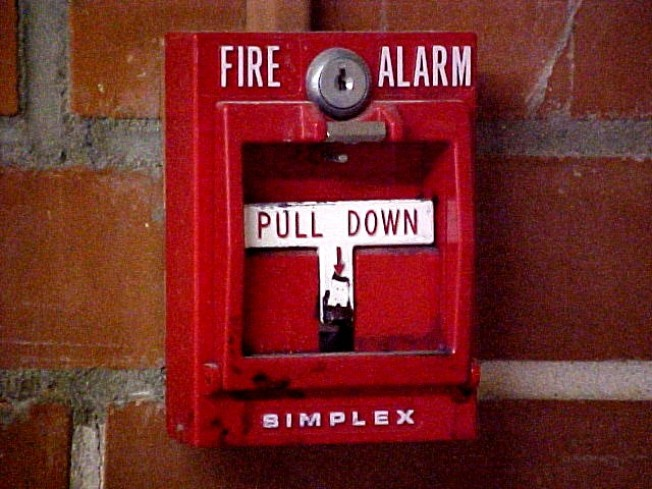Pantsless Man Pulls Fire Alarm in Police Station