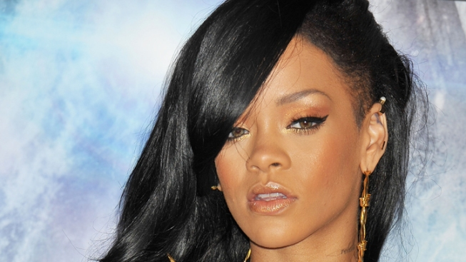 "Rihanna Would ""Love"" to Play Whitney Houston in Biopic"