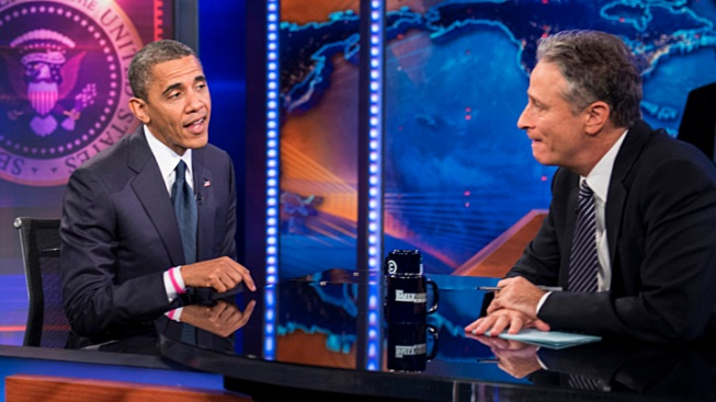 "Obama Laughs at Debate Performance, Defends Libya Response on ""Daily Show"""
