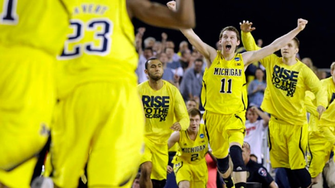 Michigan Stuns Top-Seeded Kansas in OT