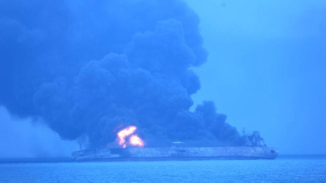 Chinese rescuers find two bodies on burning oil tanker