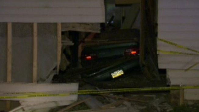 Man Crashes Car Into Home