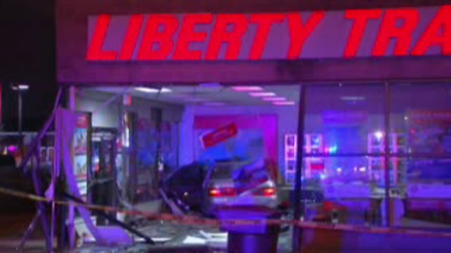 Car Crashes Into Travel Agency Building