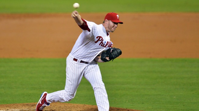 Halladay Leads Phils Over Cardinals