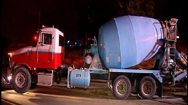 Cement Mixer Overturns, Driver Cited