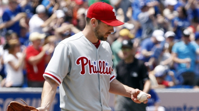 Davis Drives in Winner, Toronto Beats Phils in 10th