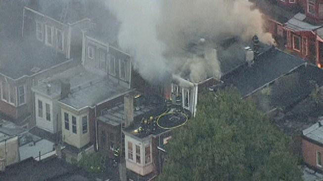 Firefighters Battle Row Home Fire