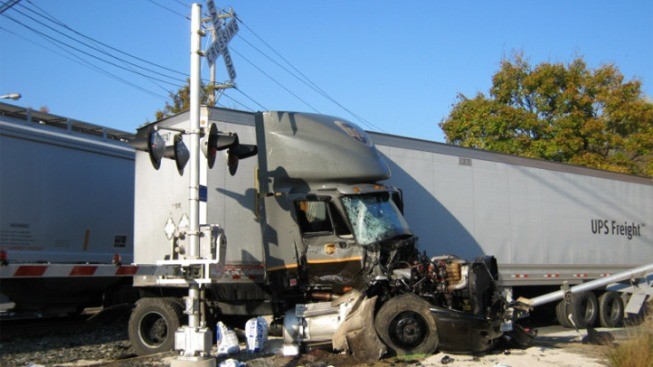 Freight Train Slams Into Tractor Trailer