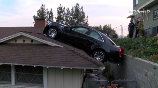 Out-of-Control Car Lands on Neighbor's Roof in L.A. Suburb