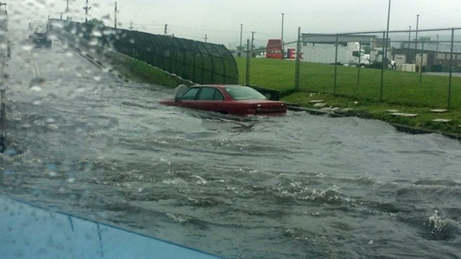 Cars Stranded on Flooded Roads in Newark