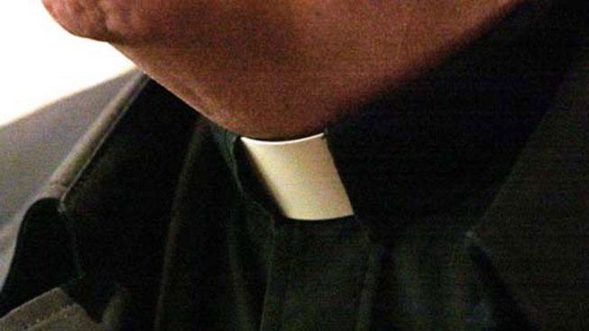 Charge Dropped in Priest-Abuse Trial