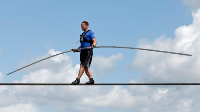 Daredevil Nik Wallenda Attempting to Walk on Wire Over Grand Canyon