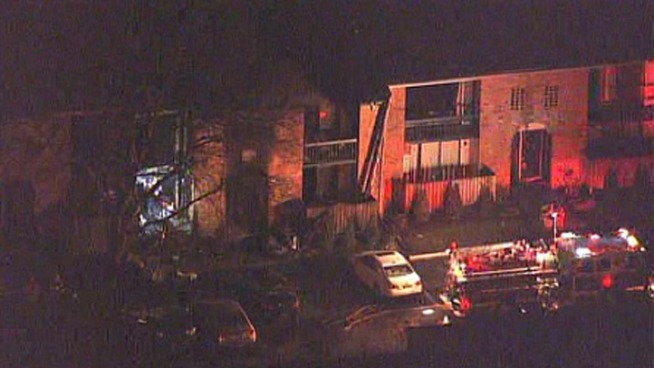 Officials are investigating the cause of an apartment fire in Delaware that displaced dozens of people and injured two.