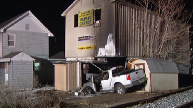 Pickup Truck Crashes Into Auto Store, Sparks Fire