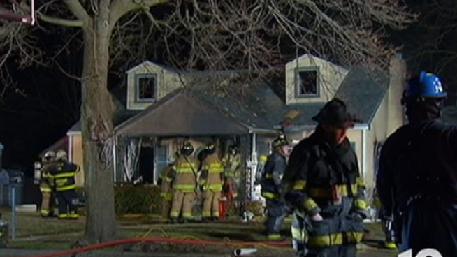 Fire investigators are trying to determine the cause of a home fire that injured a 90-year-old Montgomery County mother and her son.