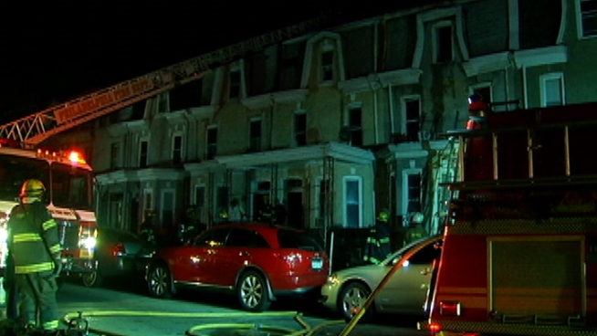 The woman was trying to escape a fire in her Germantown home when she jumped from a 3rd story window.