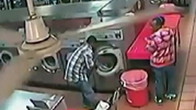 A YouTube video of a child trapped inside a washing machine at a Camden laundromat recently went viral. Sakia David the mother of the trapped toddler told NBC10's Monique Braxton that her son was with a babysitter when the incident happened.