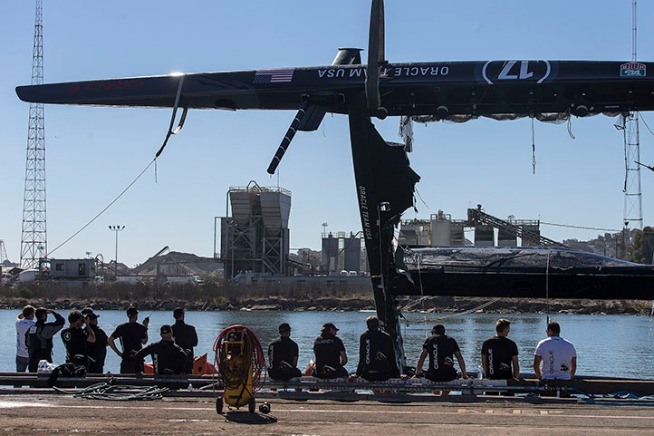 Crews on Wednesday towed ashore a nearly $8 million, 72-foot catamaran used by the Oracle Team USA, the defending America's Cup champion, out of the San Francisco Bay, after it had capsized the day before.