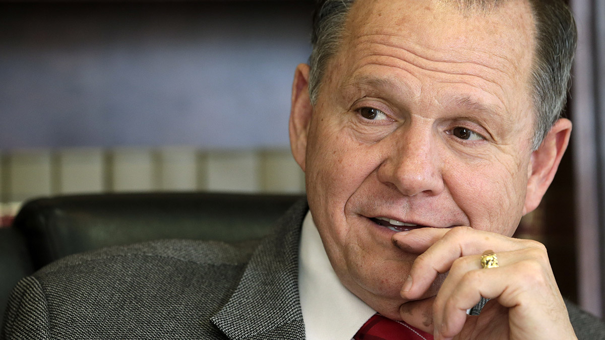In this Oct. 24, 2012 file photo, former Chief Justice Roy Moore poses for a photo in his Montgomery, Ala., office. Moore, an Alabama GOP senate candidate, used racial slurs in speech in a video obtained by NBC News.