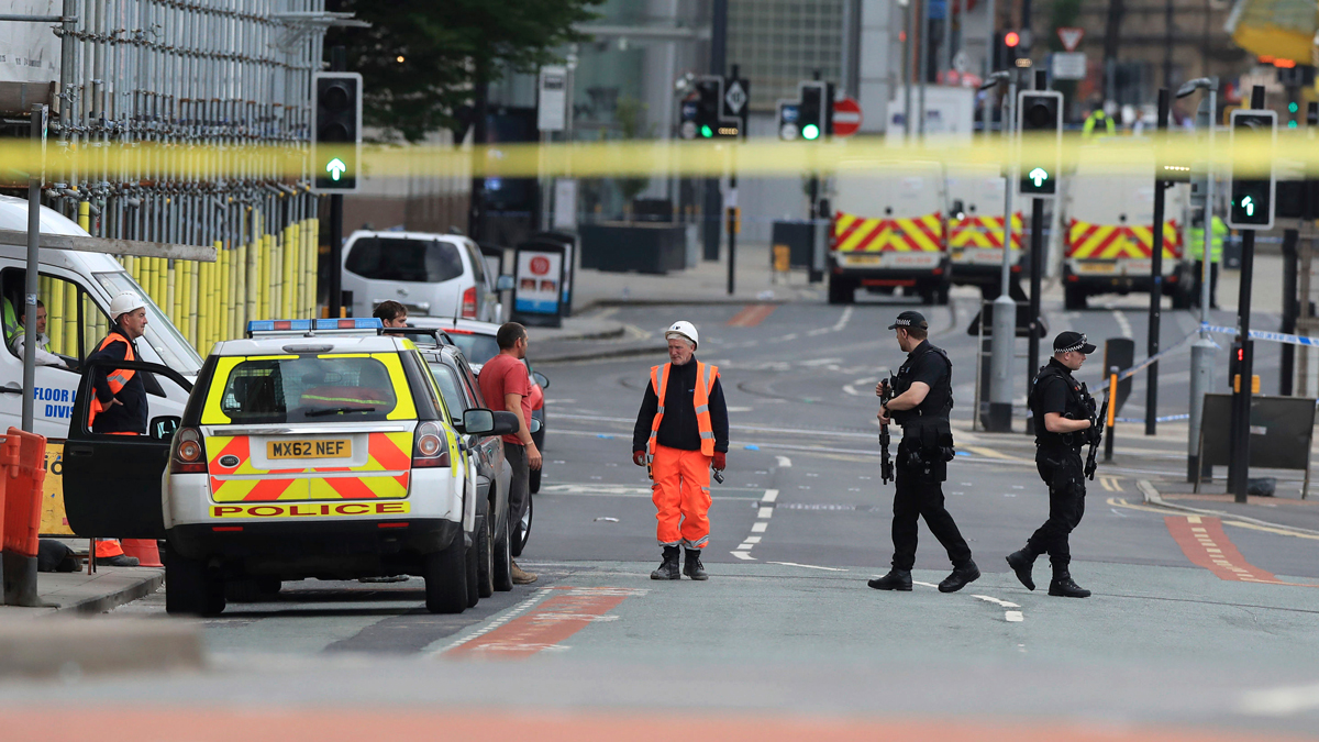Police close to the Manchester Arena in Manchester, Britain, on May 23, 2017, a day after an explosion. An apparent suicide bomber set off an improvised explosive device that killed over a dozen people at the end of an Ariana Grande concert, Manchester police said.